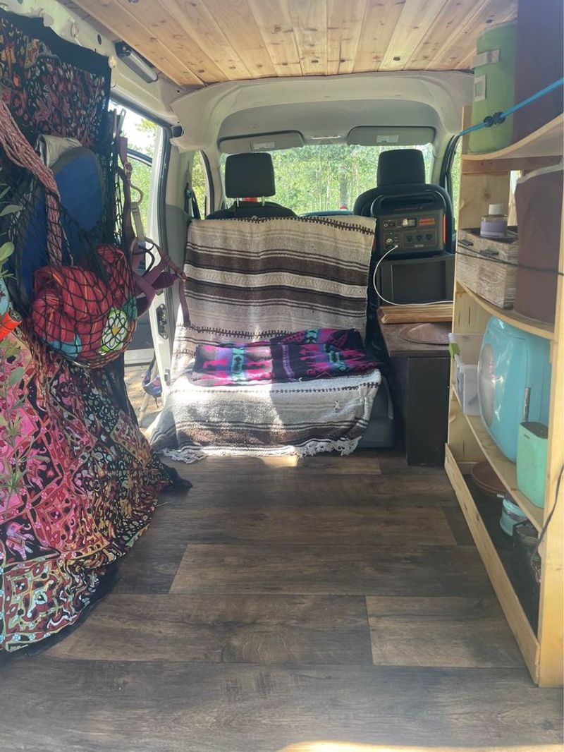 Picture 1/18 of a Nissan NV microcamper with solar for sale in Boulder, Colorado