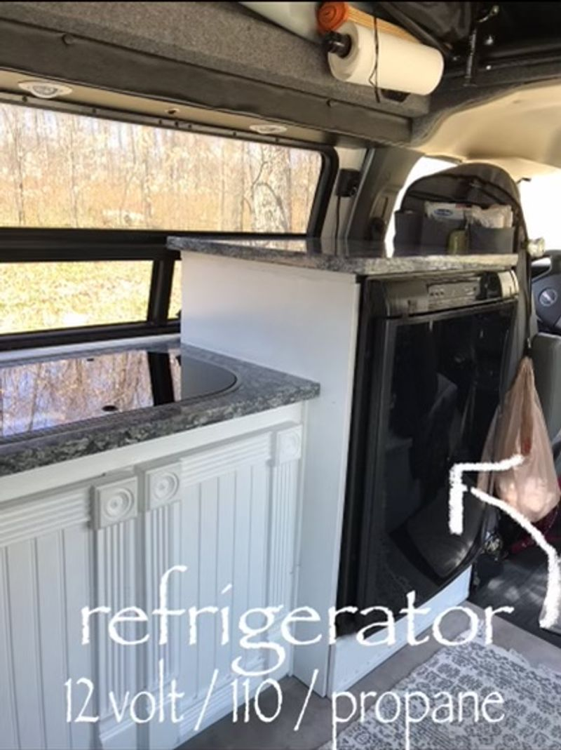 Picture 6/9 of a 2014 GMC Savana with Colorado Camper top for sale in Petoskey, Michigan