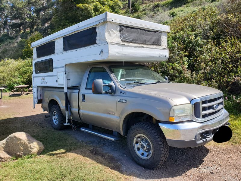 Picture 1/22 of a 04 F-250 4WD w/ pop up truck camper for sale in Seattle, Washington