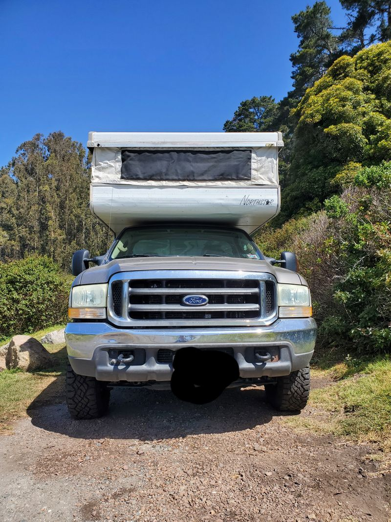 Picture 2/22 of a 04 F-250 4WD w/ pop up truck camper for sale in Seattle, Washington