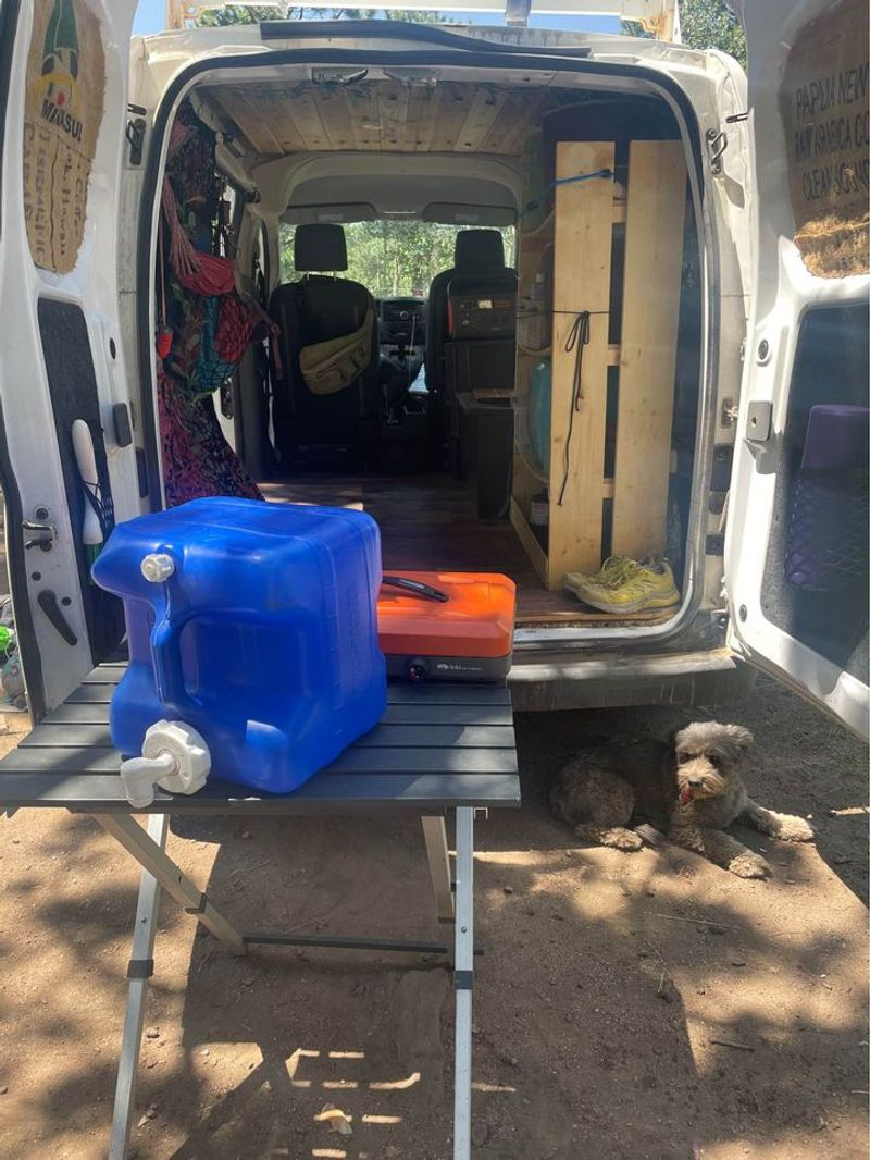 Picture 3/18 of a Nissan NV microcamper with solar for sale in Boulder, Colorado