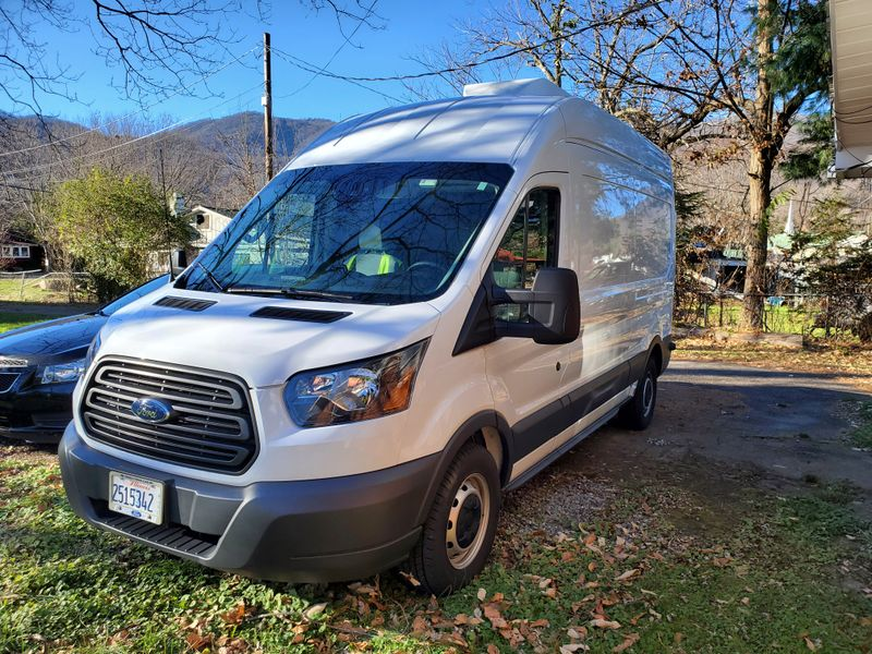 Picture 1/15 of a 2018 Ford Transit 250 High Roof Medium Length Full Sleeper with Cargo Bay  for sale in Asheville, North Carolina